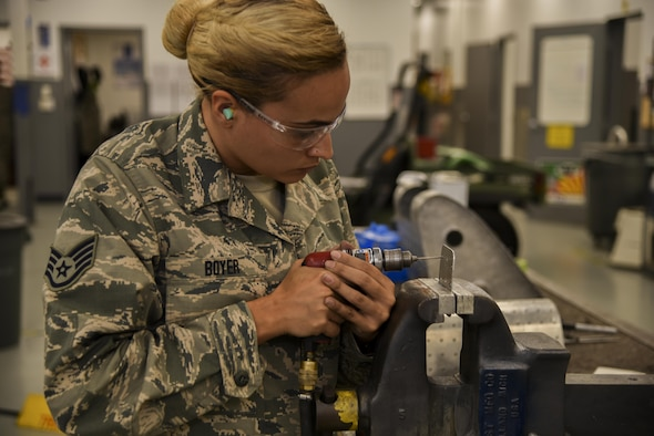 U.S. Air Force Staff Sgt. Ashlery Boyer, a structural maintenance technician assigned to the 927th Maintenance Squadron (MXS), drills on an aircraft panel at MacDill Air Force Base, Fla., Aug. 7, 2017. The 927th MXS is the associate reserve unit embedded with the 6th MXS to fabricate essential parts, keeping the KC-135 Stratotanker aircraft in the air. (U.S. Air Force Photo by Staff Sgt. Adam C. Borgman)