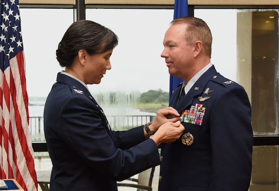 Col. Debra Lovette, 81st Training Wing commander, presents the Legion of Merit medal to Col. Scott Solomon, outgoing 81st Training Group commander, during the 81st TRG change of command ceremony in the Bay Breeze Event Center Aug. 4, 2017, on Keesler Air Force Base, Miss. The ceremony is a symbol of command being exchanged from one commander to the next by the hand off of a ceremonial guidon. Solomon passed on command of the 81st TRG to Col. Leo Lawson, Jr. (U.S. Air Force photo by Kemberly Groue)