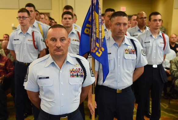 Senior Master Sgt. Andrew Bodine, 81st Training Group military training superintendent, and Airmen from the 81st TRG stand in formation during the 81st TRG change of command ceremony in the Bay Breeze Event Center Aug. 4, 2017, on Keesler Air Force Base, Miss. The ceremony is a symbol of command being exchanged from one commander to the next by the hand off of a ceremonial guidon. (U.S. Air Force photo by Kemberly Groue)