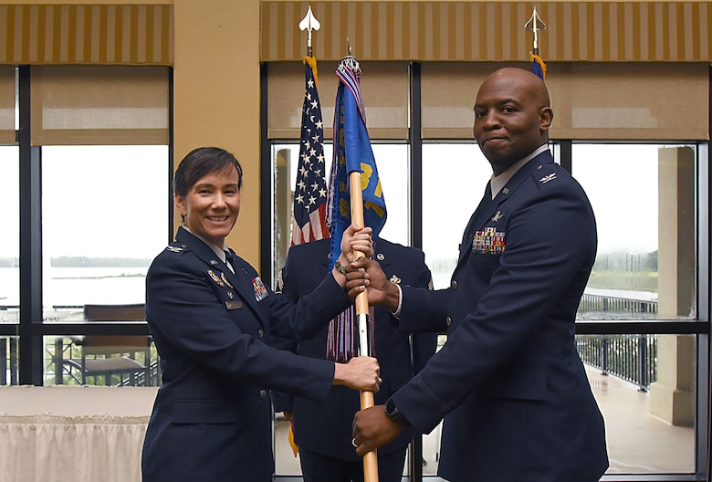 Col. Debra Lovette, 81st Training Wing commander, passes command of the 81st Training Group to Col. Leo Lawson, Jr., 81st Training Group commander, during the 81st TRG change of command ceremony in the Bay Breeze Event Center Aug. 4, 2017, on Keesler Air Force Base, Miss. The ceremony is a symbol of command being exchanged from one commander to the next by the hand off of a ceremonial guidon. (U.S. Air Force photo by Kemberly Groue)