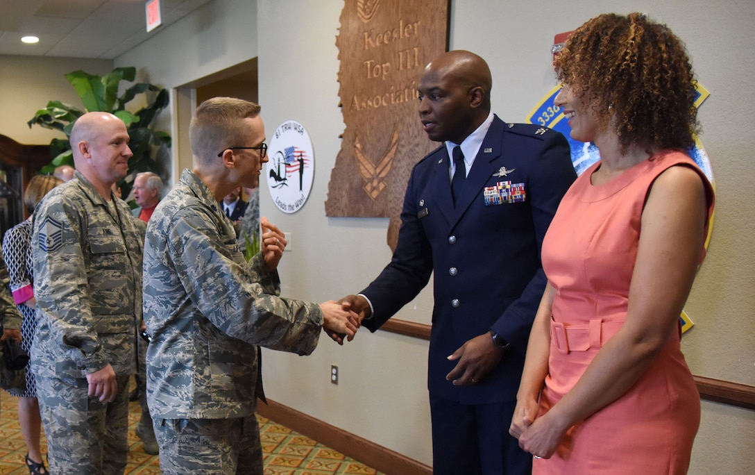 Lt. Col. Steven Lipinski, 335th Training Squadron commander, greets Col. Leo Lawson, Jr., 81st Training Group commander, during a change of command ceremony reception in the Bay Breeze Event Center Aug. 4, 2017, on Keesler Air Force Base, Miss. Lawson assumed command from Col. Scott Solomon. (U.S. Air Force photo by Kemberly Groue)