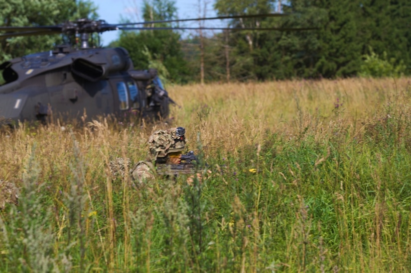 A British soldier with the 5th Battalion, The Rifles, 20th Armored Brigade, pulls security in front of a UH-60L Black Hawk helicopter during a training exercise at Saase, Estonia, Aug. 9, 2017. The British unit is currently working in Estonia as a part of Operation Atlantic Resolve, which is a NATO mission involving the U.S., allied and partnered nations in Europe in an effort to enhance regional stability and to deter aggression. Army photo by Pfc. Nicholas Vidro