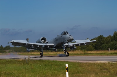 "An A-10 Thunderbolt II ""Warthog"" aircraft belonging to the 175th Wing, Maryland Air National Guard, lands on a stretch of highway during an exercise near Jagala, Estonia, Aug. 10, 2017. The exercise was a chance for the public to see NATO forces working together as a part of Operation Atlantic Resolve, which is a NATO mission involving the U.S. and Europe in a combined effort to strengthen bonds of friendship and to promote peace. Army photo by Pfc. Nicholas Vidro"