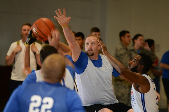 Tech. Sgt. (Ret.) Ben Clark, a warrior with the Air Force Wounded Warrior CARE Event at Offutt Air Force Base, Nebraska, competes in wheelchair basketball at the Offutt Field House Aug. 4, 2017. Clark was medically retired from the Air Force due to injuries sustained in a 2009 deployment to Iraq.