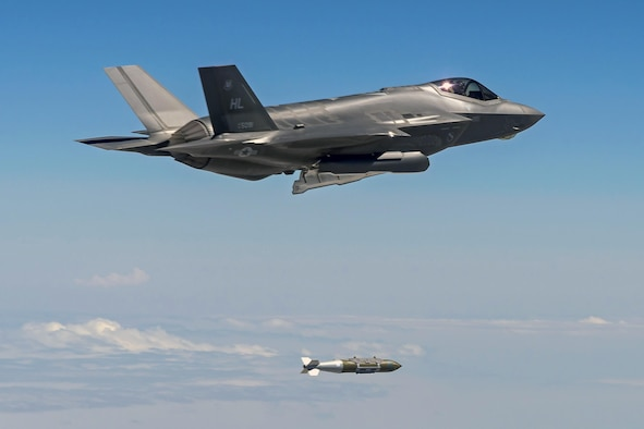 An F-35A Lightning II aircraft from Hill Air Force Base, Utah, drops a 2,000-pound GBU-31 bomb over the Utah Test and Training Range, Aug. 10. The F-35 flew Combat Hammer, an evaluation exercise which tests and validates the performance of crews, pilots, and their technology while deploying precision-guided munitions. (Photo courtesy Scott Wolff)