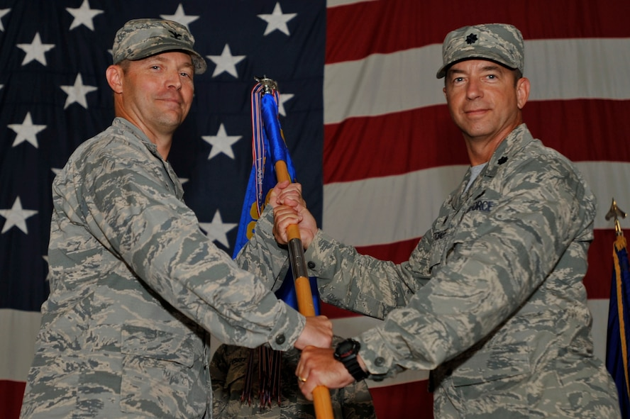 U.S. Air Force Lt. Col. Paul Netchaeff, 20th Aircraft Maintenance Squadron (AMXS) commander, receives the 20th AMXS guidon from Col. Colin Morris, 20th Maintenance Group commander, during a change of command ceremony at Shaw Air Force Base, S.C., Aug. 10, 2017.  Netchaeff assumed command of the 20th AMXS, which is comprised of roughly 700 Team Shaw members across six diverse career fields throughout three aircraft maintenance units. (U.S. Air Force photo by Senior Airman Ashley Maldonado)