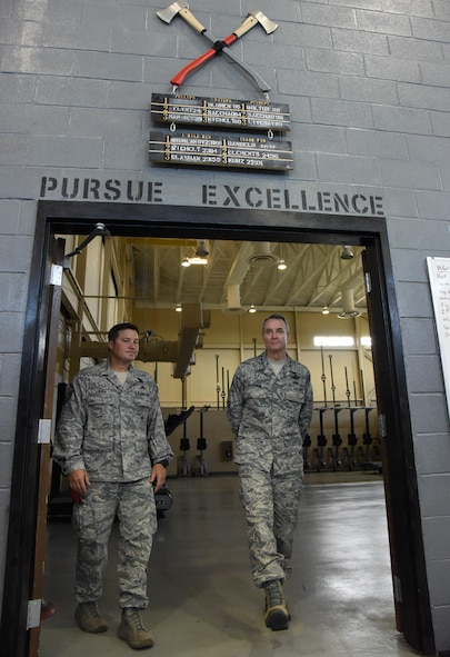 Master Sgt. Richard Lubben, 352nd Battlefield Airmen Training Squadron superintendent, walks with Lt. Gen. Darryl Roberson, commander of Air Education and Training Command, during a tour of the fitness center at Matero Hall July 19, 2017, at Keesler Air Force Base, Miss. (U.S. Air Force photo by Kemberly Groue)