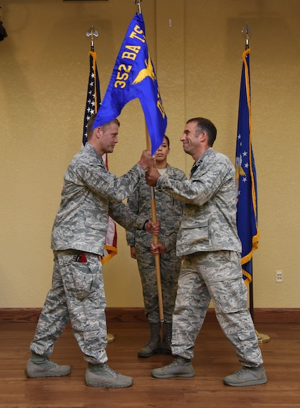 Maj. Trent Joy, 352nd Battlefield Airmen Training Squadron commander, Pope Field, N.C., passes the guidon to Capt. Jesse Sullivan, incoming Detachment 1, 352nd BA TS commander, during the Detachment 1, 352nd BA TS Activation Ceremony in the Bay Breeze Event Center Aug. 2, 2017, on Keesler Air Force Base, Miss. Sullivan assumed command of the squadron, which provides the Department of Defense, Air Force Special Operations Command and the 24th Special Operations Wing with mission ready Combat Controllers and Special Operations Weathermen. (U.S. Air Force photo by Kemberly Groue)
