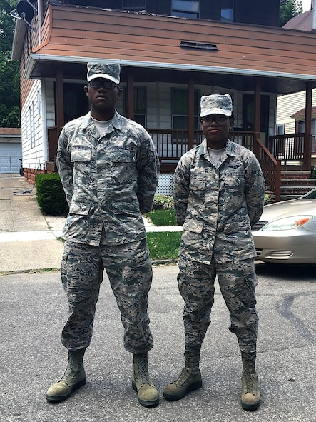 U.S. Air Force Airman 1st Class Randall Glover, a vehicle operator assigned to the 6th Logistics Readiness Squadron, and Airman 1st Class Dejahnay Fort, a boom operator assigned to the 91st Air Refueling Squadron, pause for a photo in their hometown Cleveland, Ohio. The pair participated in the Recruiter's Assistance Program together after technical training school. (Courtesy Photo)