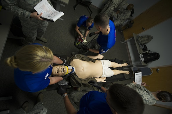 Airmen perform medical training on a dummy during the 27th Special Operations Medical Group's Emergency Medical Technician Rodeo at Cannon Air Force Base, N.M., Aug. 9, 2017. Airmen from around the world came to Cannon to participate in an annual training exercise where several stations were set up to test their skills on emergencies ranging from a broken nose to an amputation. (U.S Air Force photo by Senior Airman Lane T. Plummer)