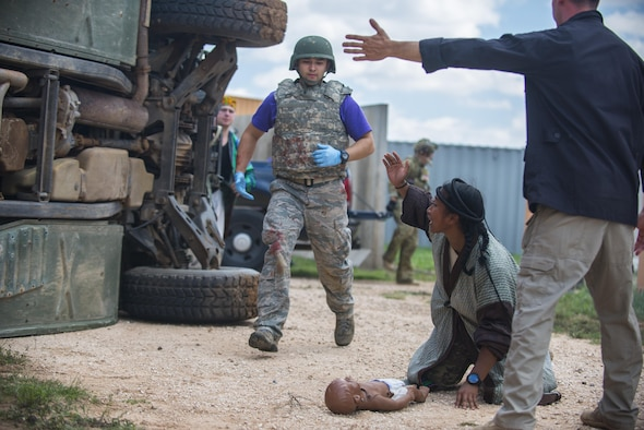 ir Force Emergency Medical Technicians rush to a simulated patient during the 27th Special Operations Medical Group's EMT Rodeo Aug. 9, 2017, at Melrose Air Force Range, New Mexico. Twenty-one teams from Air Force bases around the world visited MAFR and Cannon Air Force Base, New Mexico, to participate in the EMT Rodeo, giving the technicians a wide assortment of scenarios to test their knowledge and training in the medical field. (U.S. Air Force photo by Senior Airman Luke Kitterman/Released)