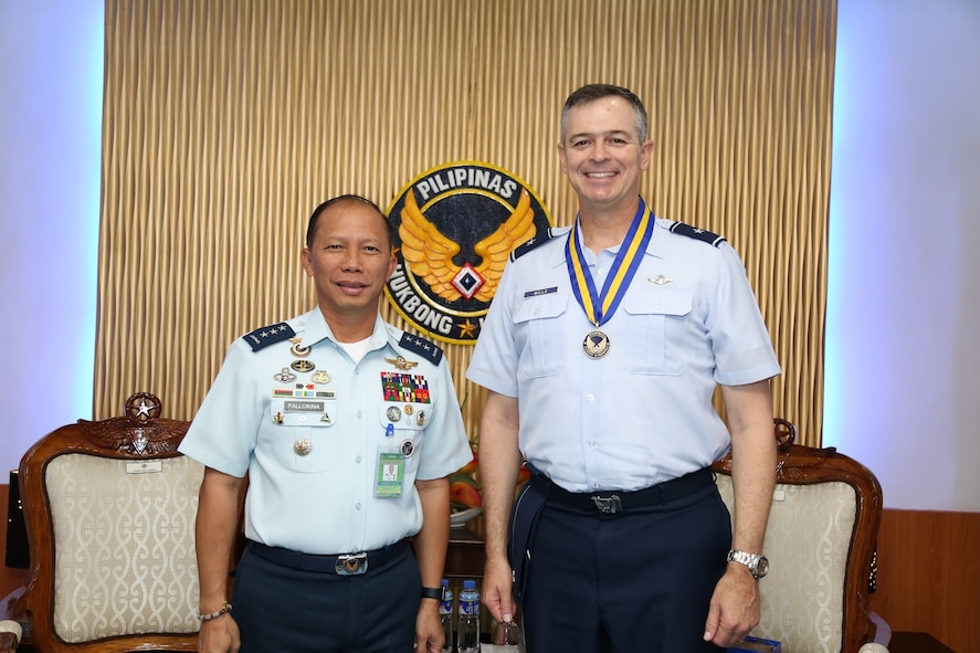 Philippine Air Force (PAF) Lt. Gen. Edgar Fallorina, PAF commanding general, left, and U.S. Air Force Brig. Gen. Craig Wills, Pacific Air Forces director of strategy, plans and programs, meet for an office call during the Airman-to-Airman (A2A) talks at Villamor Air Base, Manila, Philippines, Aug. 4, 2017. The A2A talks between Pacific Air Forces and the Philippine Air Force is a forum to plan and discuss future operations, activities and actions (OAA) and strengthen the AF-AF relationship. The talks are air forces specific enabling dialogue for regional security cooperation in air operations. (Courtesy photo/Maj. Joshua Coakley)