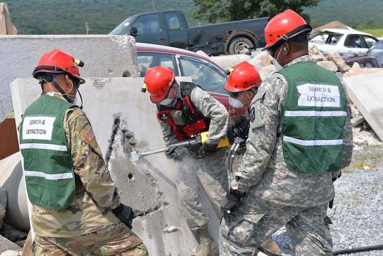 Members of the CERFP Search and Extraction Team, practice breeching heavy concrete during the mass casualty training exercise called CERFP New England on August 10, 2017 at Fort Indiantown, Pa. (U.S. Air National Guard photo by Master Sgt. Thomas Johnson)