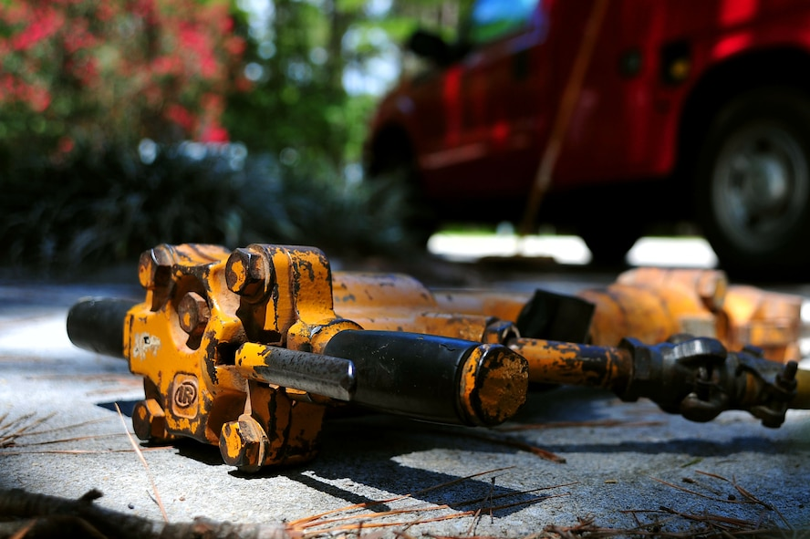 "A pneumatic 30-pound jack hammer rests on a sidewalk at Shaw Air Force Base, S.C., Aug. 10, 2017. ""Dirt Boyz,"" pavement and construction equipment Airmen assigned to the 20th Civil Engineer Squadron, used the jack hammer to break apart concrete made uneven by tree roots. (U.S. Air Force photo by Airman 1st Class Kathryn R.C. Reaves)"