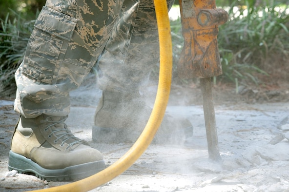 A U.S. Airman assigned to the 20th Fighter Wing puses a pneumatic 30-pound jack hammer to break concrete at Shaw Air Force Base, S.C., Aug. 10, 2017. By using a jack hammer, the Airmen broke the concrete into smaller pieces for easier removal. (U.S. Air Force photo by Airman 1st Class Kathryn R.C. Reaves)
