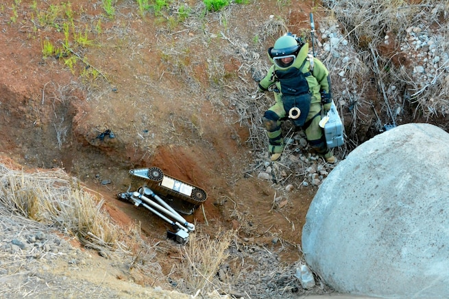 Staff Sgt. Joel Vaccaro, an Explosive Ordnance Disposal Technician from 716th Ordnance Company (Explosive Ordnance Disposal), climbs down a culvert to examine an improvised explosive device during a 2017 United States Army Pacific Command Team of the Year Competition at Schofield Barracks, Hawaii, July 29, 2017.