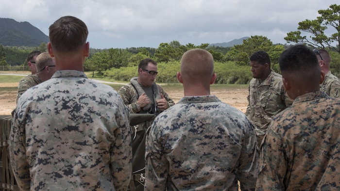 U.S. Army Aviation Battalion Japan Chief Warrant Officer 3 Jimmy Kafer, UH-60 Black Hawk pilot, briefs participants during a battalion collective training exercise July 31, 2017, in Okinawa, Japan. The exercise included the USAABJ, stationed at Camp Zama, Japan, and the 1st Battalion, 1st Special Forces Group (Airborne) stationed at Torii Station, Japan, involving cargo sling loading and parachute jump training.