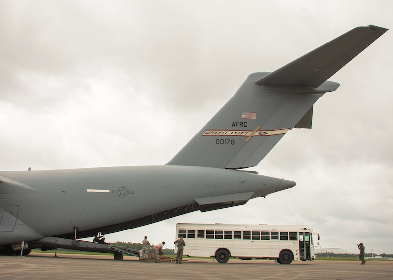 Aerial porters with the Patriot Warrior Exercise load a bus onto the back of a C-17 Globemaster III at Dobbins Air Reserve Base, Ga. Aug. 7, 2017. Aerial porters loaded a variety of items including equipment, cargo and personnel required to support the fight at the simulated frontlines of the exercise. (U.S. Air Force photo/Staff Sgt. Andrew Park)