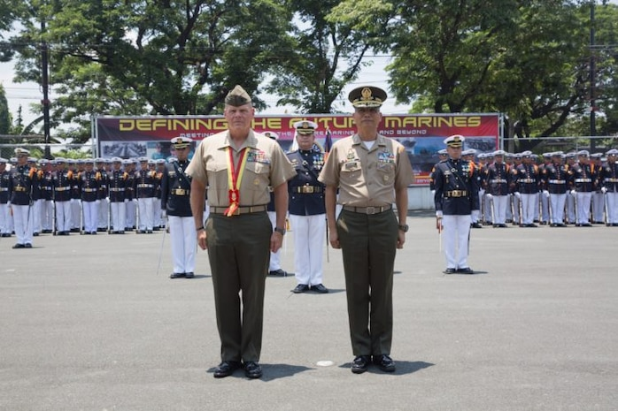 (L-R): Commandant of the U.S. Marine Corps Gen. Robert B. Neller and Commandant of the Philippine Marine Corps Maj. Gen. Emmanuel Salamat stand in front of Philippine Marines in formation as they prepared to render honors at the Philippine Heroes Memorial in Fort Bonifacio, Aug. 10, 2017.