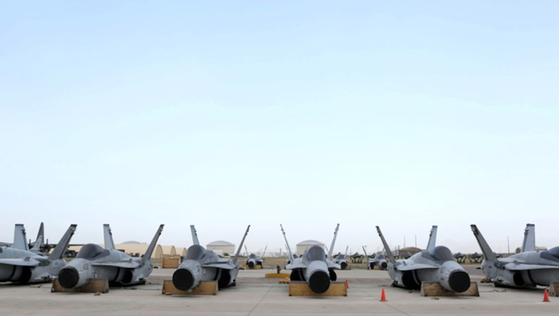 Six F/A-18C Hornets sit on the ramp at 309th Aircraft Maintenance and Regneration Group at Davis-Monthan AFB, Ariz., in preparation for transport to Boeing's maintenance facility at Cecil Airport in Jacksonville, Fla.
