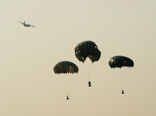A U.S. Air Force C-130 Hercules performs multiple airdrops during Exercise Mobility Guardian at Yakima Training Center, Wash., Aug. 3, 2017. More than 3,000 Airmen, Soldiers, Sailors, Marines and international partners converged on the state of Washington in support of Mobility Guardian. The exercise is intended to test the abilities of the Mobility Air Forces to execute rapid global mobility missions in dynamic, contested environments. Mobility Guardian is Air Mobility Command's premier exercise, providing an opportunity for the Mobility Air Forces to train with joint and international partners in airlift, air refueling, aeromedical evacuation and mobility support. The exercise is designed to sharpen AirmenÕs skills in support of combatant commander requirements. (U.S. Air Force photo by Senior Airman Christopher Dyer)
