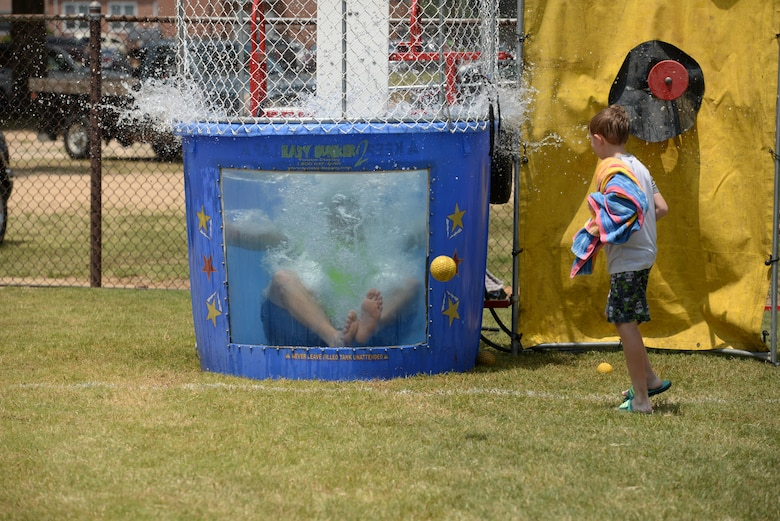 Airman 1st Class Spencer Hurlburt, 14th Operations Support Squadron Airfield Systems technician, drops into the dunk tank Aug. 4, 2017, on Columbus Air Force Base, Mississippi. Face painting, multiple inflatable water slides and a dunk tank were available at the End of Summer Bash, a family friendly event on Columbus AFB. (U.S. Air Force photo by Airman 1st Class Keith Holcomb)