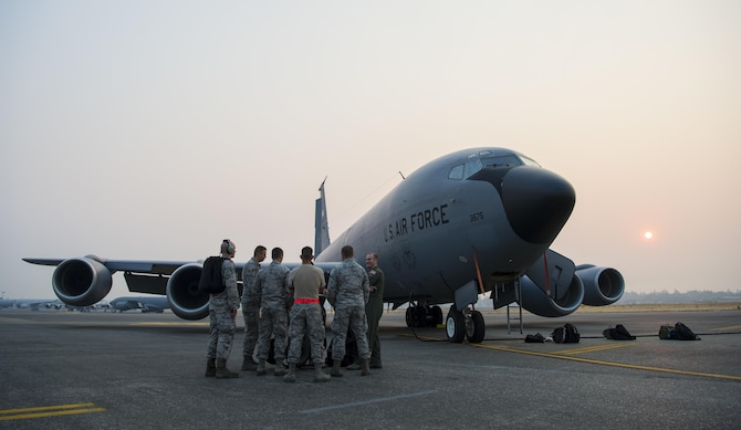 Aircrew members from the 349th Air Refueling Squadron, McConnell Air Force Base, Kan., talk with maintainers from the 22nd Aircraft Maintenance Squadron, McConnell Air Force Base, Kan., about aircraft details during Exercise Mobility Guardian, at Joint Base Lewis-McChord, Wash., Aug. 3, 2017. More than 3,000 Airmen, Soldiers, Sailors, Marines and international partners converged on the state of Washington in support of Mobility Guardian. The exercise is intended to test the abilities of the Mobility Air Forces to execute rapid global mobility missions in dynamic, contested environments. Mobility Guardian is Air Mobility Command's premier exercise, providing an opportunity for the Mobility Air Forces to train with joint and international partners in airlift, air refueling, aeromedical evacuation and mobility support. The exercise is designed to sharpen Airmen's skills in support of combatant commander requirements. (U.S. Air Force photo/Senior Airman Clayton Cupit)