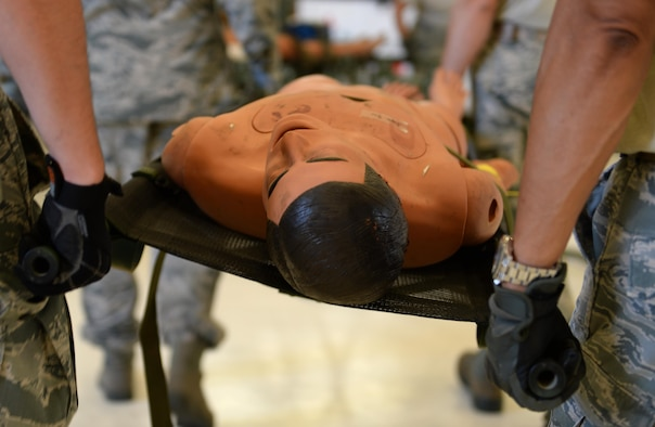 U.S. Air Force Airmen carry a simulated victim while participating in an aeromedical scenario during Exercise Mobility Guardian, Joint Base Lewis-McChord, Wash., Aug. 3, 2017. More than 3,000 Airmen, Soldiers, Sailors, Marines and international partners converged on the state of Washington in support of Mobility Guardian. The exercise is intended to test the abilities of the Mobility Air Forces to execute rapid global mobility missions in dynamic, contested environments. Mobility Guardian is Air Mobility Command's premier exercise, providing an opportunity for the Mobility Air Forces to train with joint and international partners in airlift, air refueling, aeromedical evacuation and mobility support. The exercise is designed to sharpen Airmen
