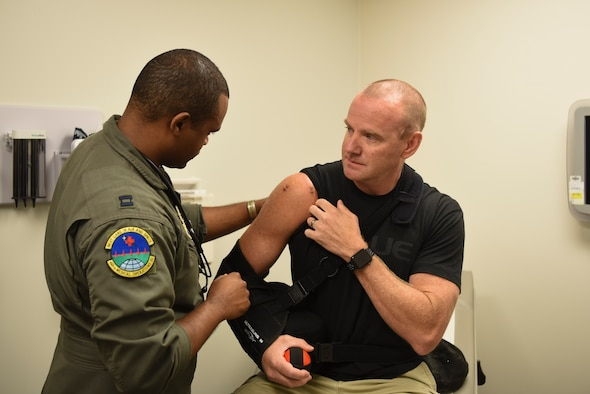 Capt. (Dr.) Jordan K. Marshall, 460th Medical Operations Squadron flight surgeon, evaluates his patient's shoulder, August 11, 2017, on Buckley Air Force Base, Colo. The Flight Medicine unit on Buckley AFB opened their new on-base facility, making it much more convenient for Team Buckley to receive medical treatment. (U.S. Air Force photo by Airman 1st Class Holden S. Faul/Released)
