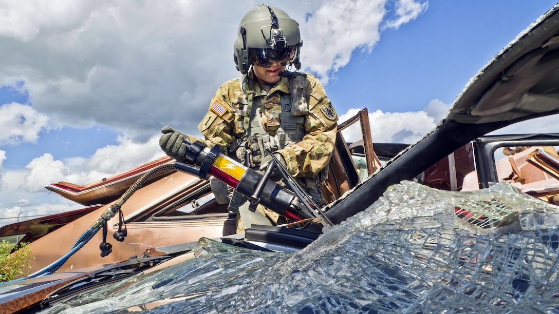 Army Sgt. Isaac Pezoa uses a rescue cutter during a vehicle extraction demonstration at Sparta/Fort McCoy Airport, Wis., Aug. 10, 2017, as part of Patriot Warrior, an Air Force Reserve training exercise. Air Force photo by Tech. Sgt. Efren Lopez
