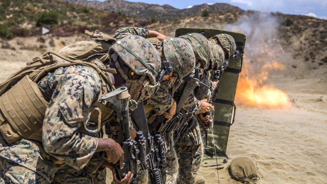 Marines line up behind a ballistic blanket before performing a simulated door breach at Camp Pendleton, Calif., Aug. 1, 2017. The Marines are assigned to Combat Service Support Company, I Marine Expeditionary Force Information Group. Marine Corps photo by Lance Cpl. Cutler Brice