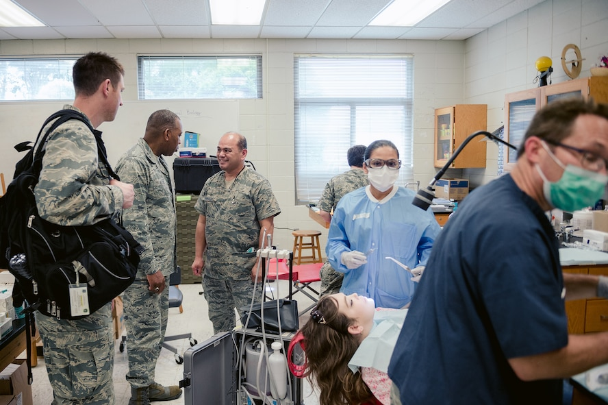 Air Force Maj. Gen. Roosevelt Allen, chief of the U.S. Air Force Dental Corps, Washington, observes dental procedures being conducted during the Smoky Mountain Medical Innovative Readiness Training exercise, Hayesville, N.C., Aug., 7, 2017. The IRT program meets training requirements for active, reserve and National Guard members and units while addressing public and society needs. (U.S. Air National Guard Photo by Staff Sgt. Ryan Campbell)