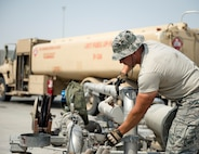 U.S Air Force Tech. Sgt. Mathew Kaski, dayshift supervisor with the 379th Expeditionary Logistics Readiness Squadron, Fuels Management Flight, completes refueling his truck at Al Udeid Air Base, Qatar, July 24, 2017. Kaski is responsible for dispensing fuel to all aircraft assigned to Al Udeid Air Base in order to meet mission requirements in support of Operation Inherent Resolve. (U.S. Air Force photo by Tech. Sgt. Amy M. Lovgren)