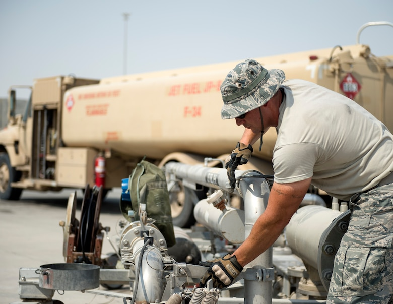 U.S Air Force Tech. Sgt. Mathew Kaski, dayshift supervisor with the 379th Expeditionary Logistics Readiness Squadron, Fuels Management Flight, completes refueling his truck at Al Udeid Air Base, Qatar, July 24, 2017.