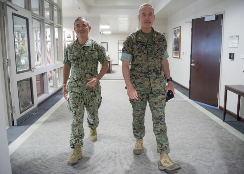 Marine Corps Gen. Joe Dunford, chairman of the Joint Chiefs of Staff, right, meets with Navy Adm. Harry B. Harris Jr., commander of U.S. Pacific Command, at Joint Base Pearl Harbor-Hickam, Aug. 11, 2017. Dunford stopped by the command prior to departing for Korea, China and Japan. DoD photo by Navy Petty Officer 1st Class Dominique A. Pineiro