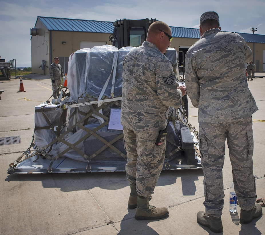 An air transportation supervisor checks an increment monitor into the drop-off area for the deployment exercise.