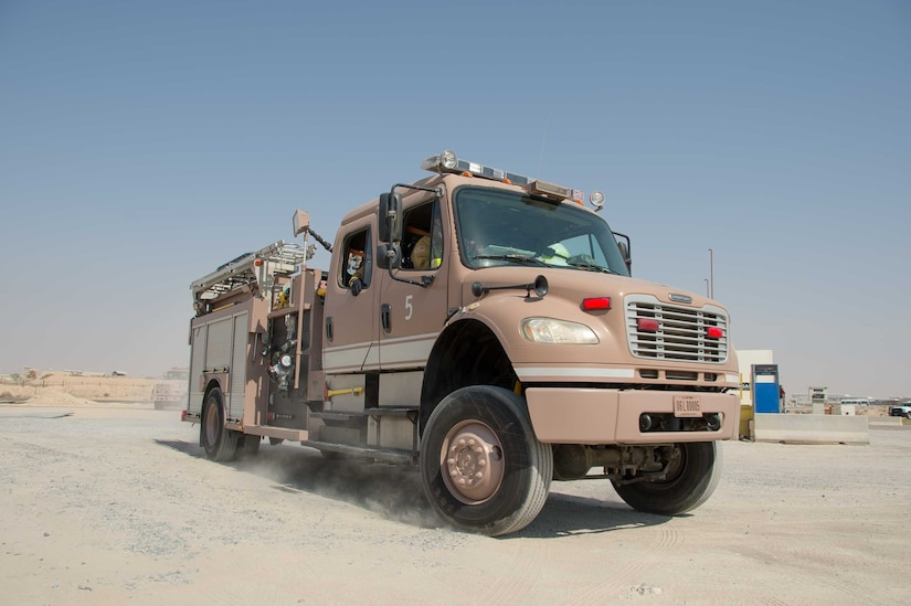 A 386th Air Expeditionary Wing fire truck comes to a stop at the scene of an incident during a training scenario Friday, August 11, 2017, at the PERSCO building at an undisclosed location in Southwest Asia. (U.S. Air Force photo by 1st Lt. Rashard Coaxum)
