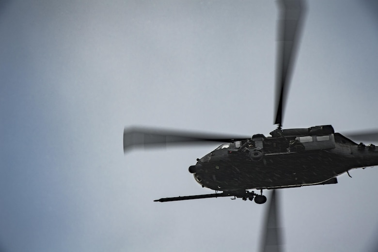 Airmen from the 38th and 41st Rescue Squadrons fly in an HH-60G Pave Hawk during combat search and recovery training as part of Stealth Guardian, Aug. 10, 2017, in the skies over the Apalachicola National Forest, Fla