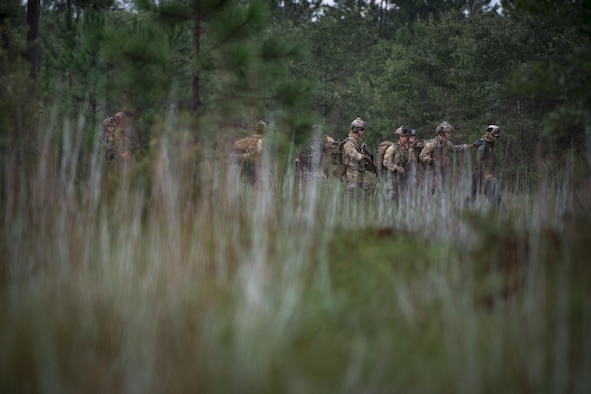 Pararescuemen from the 38th Rescue Squadron move a downed pilot during combat search and rescue training as part of Stealth Guardian, Aug. 10, 2017, in the Apalachicola National Forest, Fla.