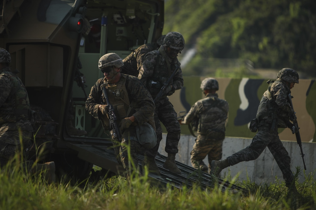 U.S. and South Korean Marines exit from a South Korean amphibious assault vehicle.