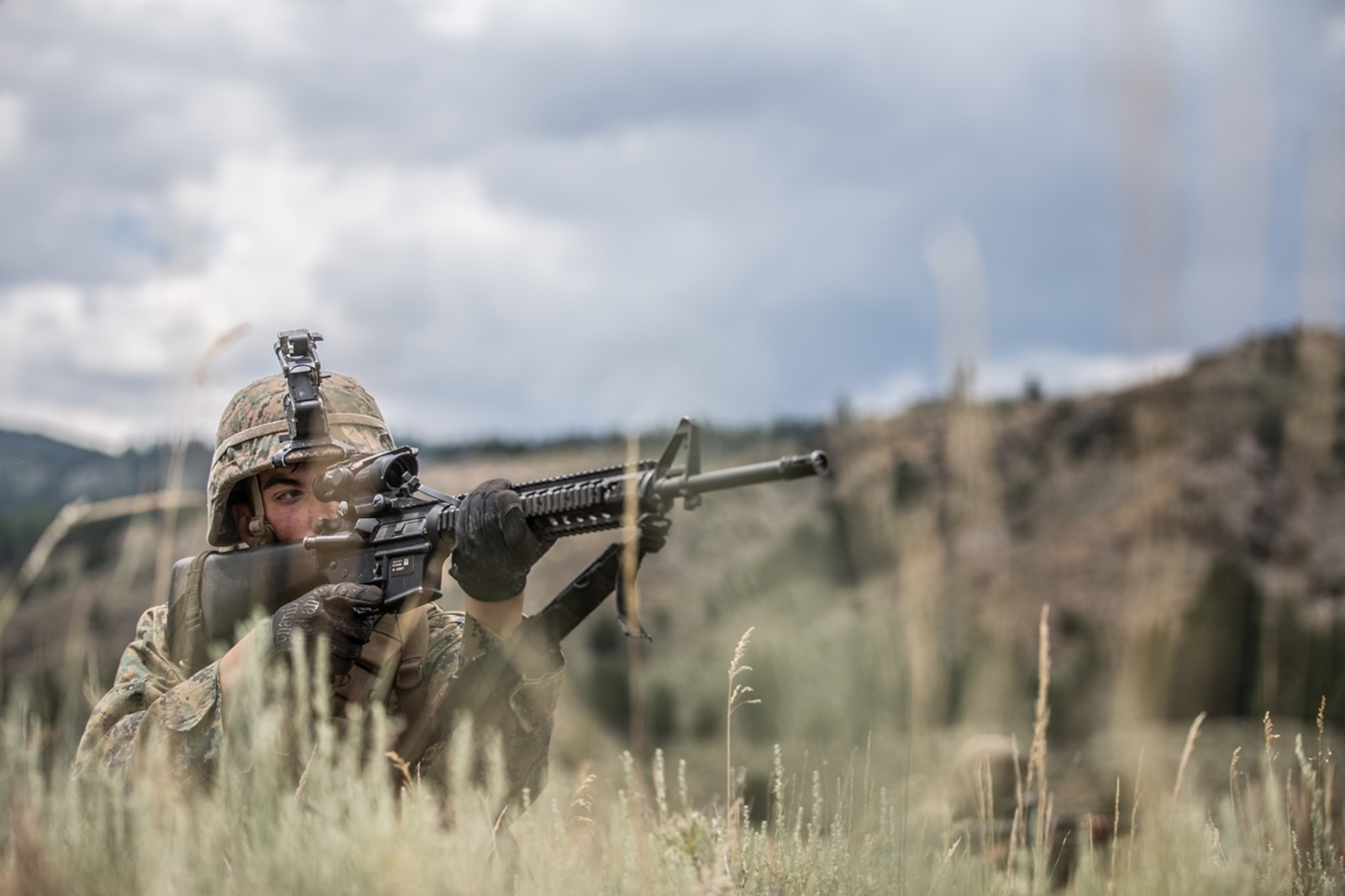 BRIDGEPORT, Calif. - U.S. Marine Pfc. Morris Jones, a motor transportation operator with Combat Logistics Battalion 5, Combat Logistics Regiment 1, 1st Marine Logistics Group, posts security during a combat physical training session during a field operation while participating in Mountain Training Exercise 4-17 at Marine Corps Mountain Warfare Training Center, Aug. 2, 2017. Marines participating in Mountain Training Exercise post security to demonstrate protecting various areas against any possible simulated attack or ambush in the mountainous terrain. (U.S. Marine Corps photo by Lance Cpl. Timothy Shoemaker)