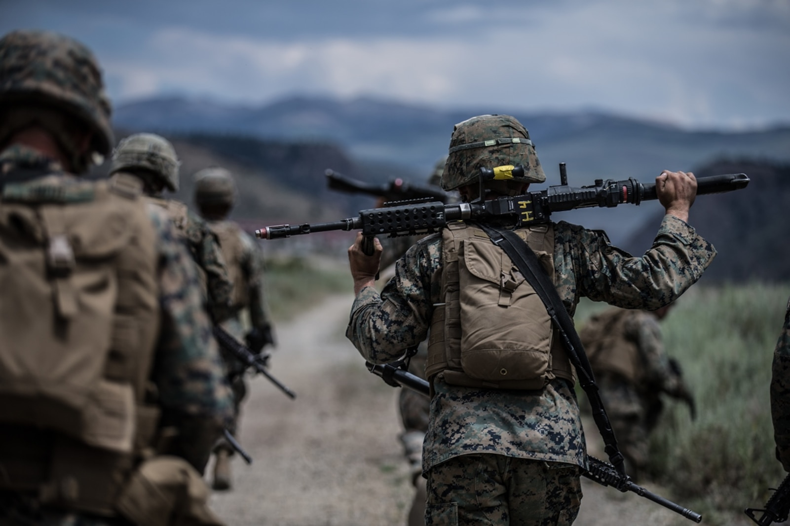 BRIDGEPORT, Calif. - U.S. Marines with Combat Logistics Battalion 5, Combat Logistics Regiment 1, 1st Marine Logistics Group, hike towards a target point to conduct a combat physical training session during Mountain Training Exercise 4-17 at Marine Corps Mountain Warfare Training Center in Aug. 2, 2017. During the Mountain Warfare Training Marines are required to complete multiple hikes, these are meant to keep Marines in peak physical condition during the exercise. (U.S. Marine Corps photo by Lance Cpl. Timothy Shoemaker)