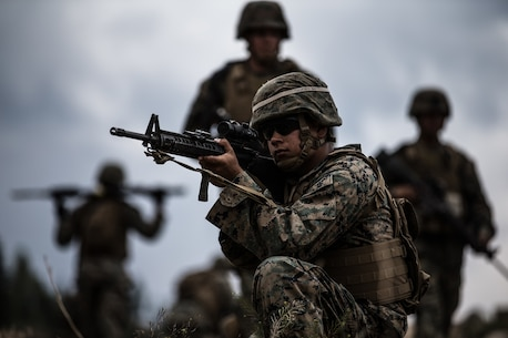 BRIDGEPORT, Calif. - U.S. Marine Cpl. Parris Jones, a motor vehicle operator with Combat Logistics Battalion 5, Combat Logistics Regiment 1, 1st Marine Logistics Group, posts security during a combat physical training session as part of Mountain Training Exercise 4-17 at Marine Corps Mountain Warfare Training Center, Aug. 2, 2017. Marines participating in Mountain Training Exercise post security to demonstrate protecting various areas against any possible simulated attack or ambush in the mountainous terrain. (U.S. Marine Corps photo by Lance Cpl. Timothy Shoemaker)