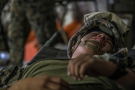 BRIDGEPORT, Calif. - U.S. Marine Pfc. Nelson Ramirez, a motor vehicle operator with Combat Logistics Battalion 5, Combat Logistics Regiment 1, 1st Marine Logistics Group, assumes the role of a casualty during a simulated casualty drill as part of Mountain Training Exercise 4-17 at Mountain Warfare Training Center, Aug. 2, 2017. The Mountain Warfare Training Center is 6800 feet above sea level and exists to train units in complex compartmented terrain. Simulated casualty drills provide Marines with the opportunity to operate in its unique terrain and overcome various environmental obstacles. (U.S. Marine Corps photo by Lance Cpl. Timothy Shoemaker)