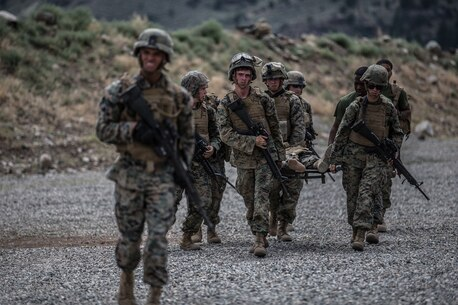 BRIDGEPORT, Calif. - U.S. Marines with Combat Logistics Battalion 5, Combat Logistics Regiment 1, 1st Marine Logistics Group, carry a simulated casualty during a simulated casualty drill as part of Mountain Training Exercise 4-17 at Mountain Warfare Training Center, Aug. 2, 2017. Simulated casualty drills are designed to train Marines how to properly care for and evacuate casualties while under stressful conditions, and which require quick thinking to save lives. (U.S. Marine Corps photo by Lance Cpl. Timothy Shoemaker)