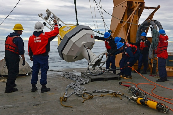 HEALY's deck crew set a NOAA buoy in the Arctic Ocean in support of the 1701 science mission.