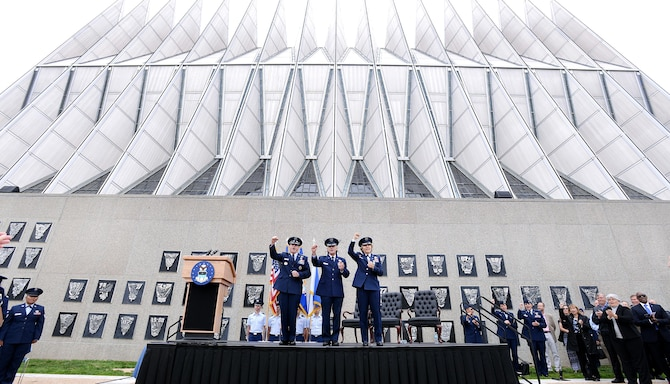 From left to right: U.S. Air Force Chief of Staff Gen. David Goldfein, U.S. Air Force Academy Superintendent Lt. Gen. Jay Silveria, and former-Superintendent of the Academy Lt. Gen. Michelle Johnson, sing the U.S. Air Force Song at the culmination of a change of command ceremony which saw Silveria replace Johnson as the superintendent Aug. 11, 2017 at the Academy. (U.S. Air Force photo/Jason Gutierrez)