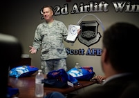 Master Sgt. Mike Burgess, 932nd Airlift Wing Safety Office, speaks during the 932nd Airlift Wing Boss Day event on August 5, 2017, Scott Air Force Base, Illinois. Burgess used some humor to deliver messages of safety to employers who came out to see how the reserve unit trains on a unit training assembly weekend. Key points discussed by Burgess were process management, identifying hazards, implementing controls, evaluations, motorcycle safety, being a good wingman and the critical days of summer. (U.S. Air Force photo by Tech. Sgt. Christopher Parr)