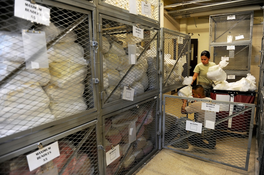 U.S. Air Force Staff Sgts. Joel Valencia and Rosita Francisco, both services craftsmen assigned to the 254th Force Support Squadron, Guam Air National Guard, sort and store linen in the contingency dormitories Aug. 9, 2017, during RED FLAG-Alaska (RF-A) 17-3, at Eielson Air Force Base, Alaska. Valencia and Francisco are part of a five-man team from the 254 FSS supporting RED FLAG-Alaska 17-3, the world's premier tactical joint and coalition air combat employment exercise. (U.S. Air Force photo by Staff Sgt. Jerilyn Quintanilla)