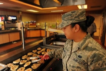 U.S. Air Force Staff Sgt. Jericha Lanaan, a services craftsman assigned to the 254th Force Support Squadron, Guam Air National Guard, grills chicken in preparation for the lunch rush at the Two Seasons dining facility, Aug. 9, 2017, during RED FLAG-Alaska (RF-A) 17-3, on Eielson Air Force Base, Alaska. This is Lanaan's third TDY to Eielson in support of RED FLAG-Alaska. (U.S. Air Force photo by Staff Sgt. Jerilyn Quintanilla)